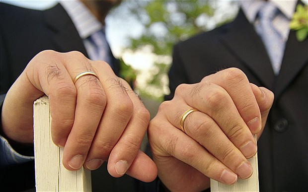 Gay Holding Hands Wedding Rings