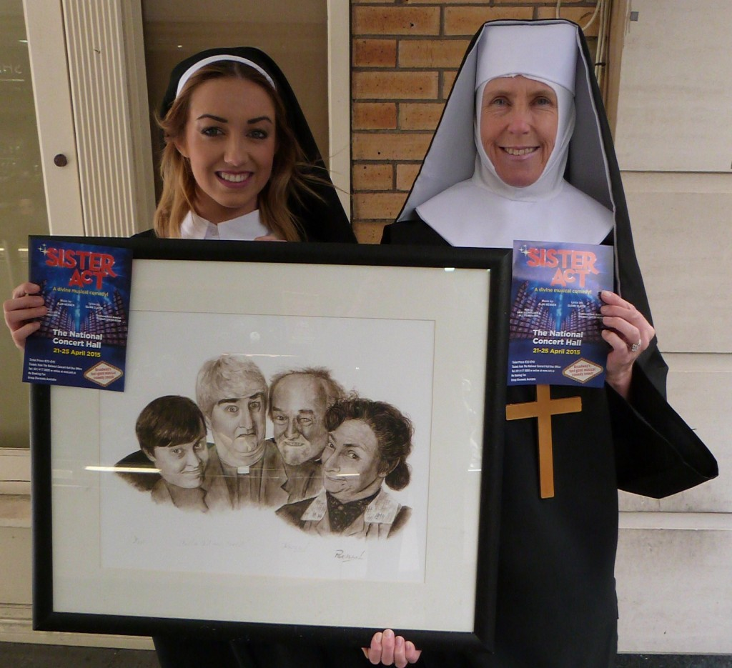 Lauren Walsh (left) and Fiona Dowling (right) with the Fr Ted watercolour painting by Dublin artist, Pervaneh Matthews outside Balla Bán Art Gallery, Westbury Mall, Dublin 2 (101)