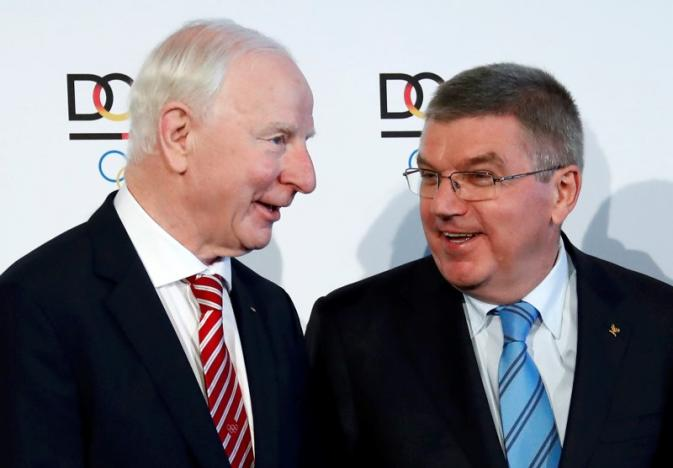 European Olympic Committee (EOC) President Patrick Hickey (L) and International Olympic Committee President (IOC) Thomas Bach (C) arrive for a ceremony in Frankfurt, Germany, May 20, 2016. REUTERS/Kai Pfaffenbach/Files