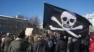 "Thousands of Icelanders rally in Reykjavik on April 9, 2016 to demand immediate elections on a sixth consecutive day of anti-government protests over the ""Panama Papers"" revelations which have already toppled the prime minister. / AFP / HALLDOR KOLBEINS (Photo credit should read HALLDOR KOLBEINS/AFP/Getty Images)"