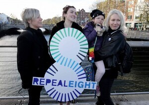 NO REPRO FEE 25/11/2016 Coalition to Repeal the Eighth Amendment hosted a Women Rising 2016 Rally today in Dublin. Pictured at the lunchtime rally 'Women Rising in Solidarity 2016' on Rosie Hackett Bridge, Dublin were, from left, Sarah Francis, Lucy Watmough, six-year-old Isis Pendergast and her mother Rachel. The rally was organised to demand that the Irish Government take action to respect and protect women's lives, health and choices. Supporters were encouraged to wear black and tweet their support using #Black4Repeal. The rally is one of two Irish events that took place today (25.11.2016) as part of an international day of support for women in countries where abortion is banned or difficult to access. Some of the countries participating around the world include Brazil, Peru, Ecuador, Poland, Chile, Argentina, Mexico and Italy.  PHOTO: Mark Stedman