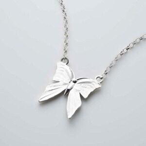 3 I Still Get Butterflies Pendant by deBláca