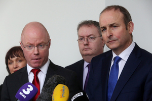 2/2/2017 . Stephen Donnelly Joins Fianna Fail. Pictured (LTOR) Stephen Donnelly (Glasses) with Fianna Fail party leader Micheal Martin TD talking to the media outside Leinster House this afternoon after Stephen announced today he was joining Fianna Fail. He has been appointed the partys Front Spokeperson on Brexit. Photo: Sam Boal/RollingNews.ie