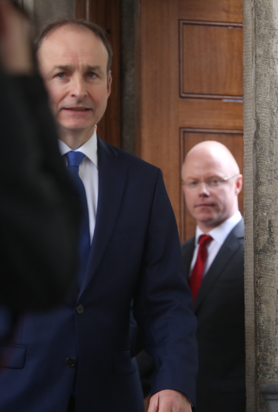 2/2/2017 . Stephen Donnelly Joins Fianna Fail. Pictured (RTOL) Stephen Donnelly (Glasses) with Fianna Fail party leader Micheal Martin TD talking to the media outside Leinster House this afternoon after Stephen announced today he was joining Fianna Fail. He has been appointed the partys Front Spokeperson on Brexit. Photo: Sam Boal/RollingNews.ie