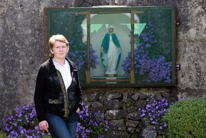 File Photo . More Bones have been found at the Tuam mother and Baby site End ..05/06/2014. Tuam mother and baby home infant deaths. Local Tuam historian Catherine Corless, pictured beside a grotto in the grounds where the unmarked mass grave containing the remains of nearly 800 infants who died at the Bon Secours mother-and-baby home from 1925-1961 rests. The site is now part of the Dublin Road housing estate and records show that the former mother and baby home's septic tank was in this location. The names of the children buried here have been confirmed by Corless' research and she hopes to raise funds to erect a plaque as a memorial to them. Photo: Laura Hutton/RollingNews.ie