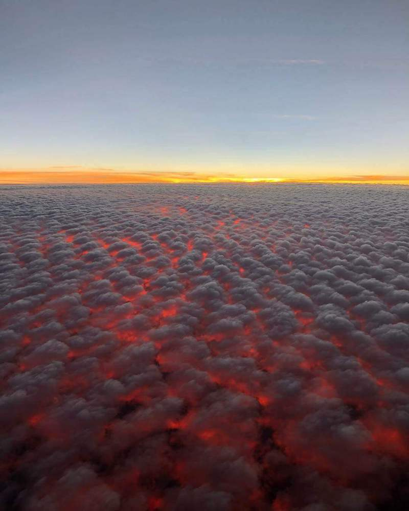 A Spectacular Photograph Of Sunset Captured From An Altitude 9 Kilometres Though Altocumulus Cloudfield By Redditor Couragethechicken