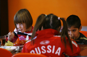 Orphan children have a meal at an orphanage in the southern Russian city of Rostov-on-Don