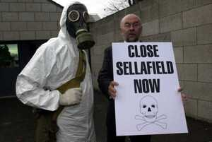 RUAIRI QUINN SHUT SELLAFIELD ANTI NUCLEAR CAMPAIGN IN IRELAND DEMO CHEMICAL SUITS GAS MASKS