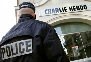 policeman-stands-guard-outside-french-satirical-weekly-quotcharlie-hebdoquot-paris-after-it