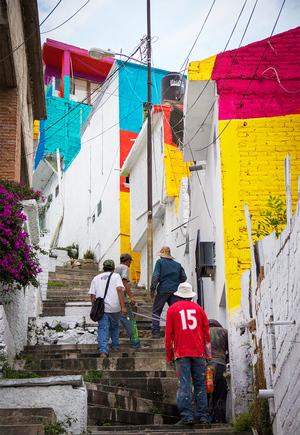 germen-crew-paint-neighborhood-street-art-mexico-designboom-01