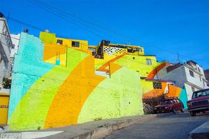 germen-crew-paint-neighborhood-street-art-mexico-designboom-05