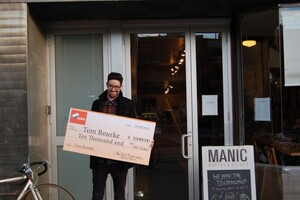 tom-with-cheque