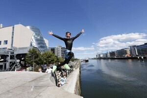 18/07/2016 Dublin Weather Scenes. Pictured is Brooklyn Sanders from Finglas jumping into the water while enjoying the sunny weather in Liffey River at The Docklands Area in Dublin with fore casted highest temperatures of 22 to 28 Degrees Celsius. Photo RollingNews