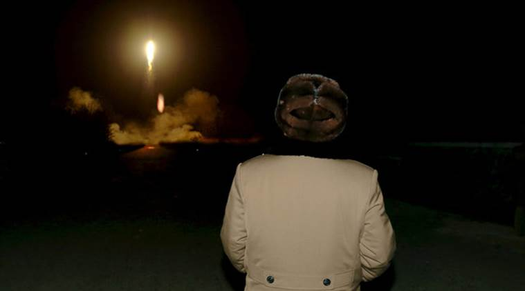 KCNA file picture shows North Korean leader Kim Jong Un watching the ballistic rocket launch drill of the Strategic Force of the Korean People's Army at an unknown location