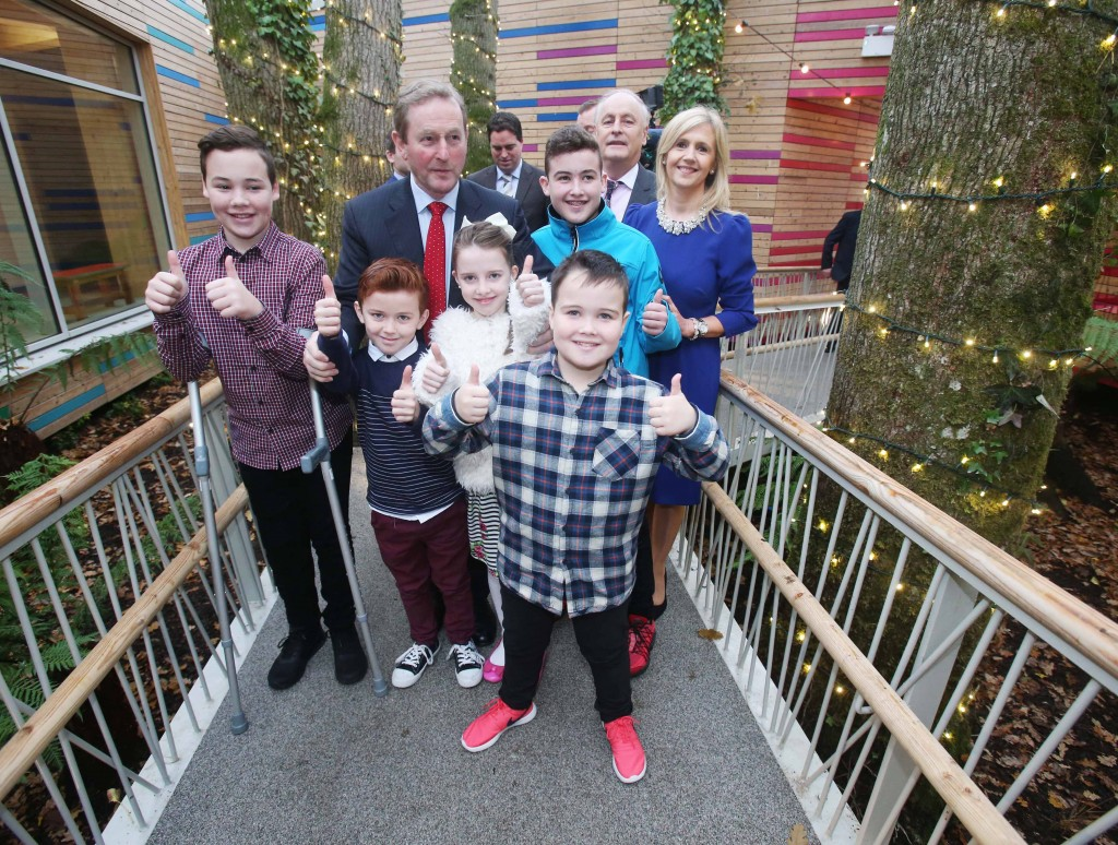 NO REPRO FEE 09/12/2016 Pictured at Barretstown Castle in Co. Kildare today were An Taoiseach, Enda Kenny T.D., Maurice Pratt, Chair of Barretstown and Dee Ahearn, CEO Barretstown with Ben MacHugh (14, blue jacket), his brothers David (12, left) and Patrick (9, front), and Cillian McDonnell (9, 2nd from left) and his sister Cliodhna (10), as An Taoiseach, Enda Kenny T.D. officially opened the new Dining Hall at Barretstown, the charity for seriously ill children. 'Elizabeth's Tree House', the new 'heart' of the camp is specifically designed to meet the needs of campers, providing a combination of excitement and tranquillity inside its modern tree house design. Photograph: Leon Farrell / Photocall Ireland