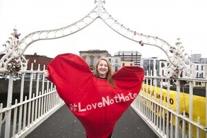 "20/1/2017. Donald Trump banners. Pictured is Siona Cahil from Union Students of Ireland at the Hapenny Bridge in Dublin. Today Donald Trump's Presidential inauguration was marked by the dropping of a banner from the Ha'penny bridge which reads ""BRIDGES NOT WALLS – Love Trumps Hate. The events is one of scores of similar events across 3 continents in solidarity with people in the US who are likely to be the targets of the hate which has become associated with the Trump campaign.The action is coordinated by the European Network Against Racism Ireland (ENAR Ireland) and is supported by the Immigrant Council of Ireland, The Union of Students in Ireland (USI), the Migrant Rights Centre Ireland (MRCI) and other ENAR Ireland network members. Photo:Leah Farrell/RollingNews.ie"