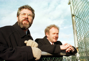 File Photo: This Monday will be a crucial day in the life of former Deputy First Minister and former leader of the Provisional IRA, Martin McGuinness as he faces into the latest crisis in the Northern Ireland Peace Process. End. Good Friday Agreement. L TO R. Sinn Fein President Gerry Adams and Chief Negotiator Martin McGuinness look over the wire in Stormont Castle at lunch time after putting their final approval to the Good Friday (Belfast Agreement) peace agreement. 10/4/1998 Photo: Eamonn Farrell/RollingNews.ie
