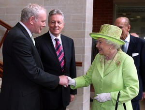 File Photo: Martin McGuinness Has Died. End. 27/06/2012. QUEEN MCGUINNESS HANDSHAKE. Queen Elizabeth II shakes hands with Northern Ireland Deputy First Minister Martin McGuinness watched by First minister Peter Robinson (centre) at the Lyric Theatre in Belfast. Pic: Photo: RollingNews.ie/PA