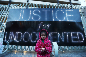 16/03/2017. Irelands Undocumented Migrants - Support All Undocumented in the USA. Pictured Smantha (6) from Dublin joins a demonstration outside the Central Bank in Dublin in support off all the Undocumented in the USA. Photo: Sam Boal/Rollingnews.ie
