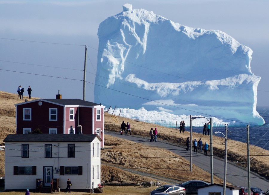 """Residents view the first iceberg of the season as it passes the South Shore, also known as """"Iceberg Alley"""", near Ferryland Newfoundland, Canada. REUTERS/Jody Martin"""